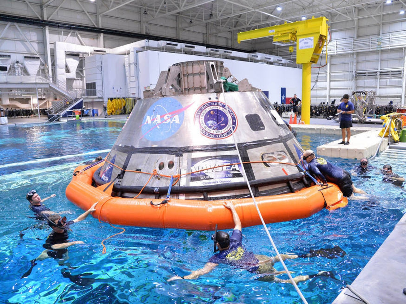 Divers training at the Johnson Space Center.