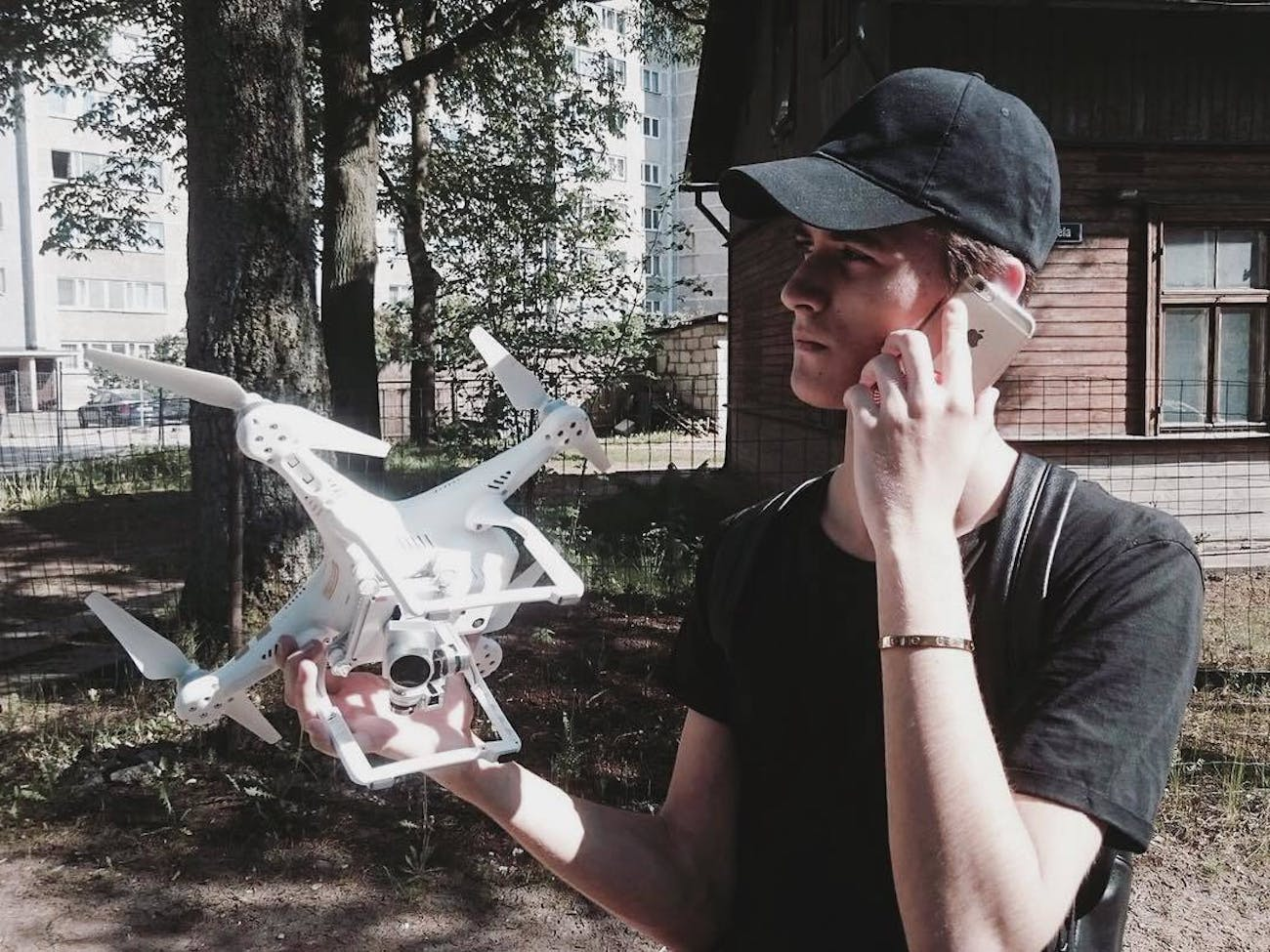 Geskin holding a drone.