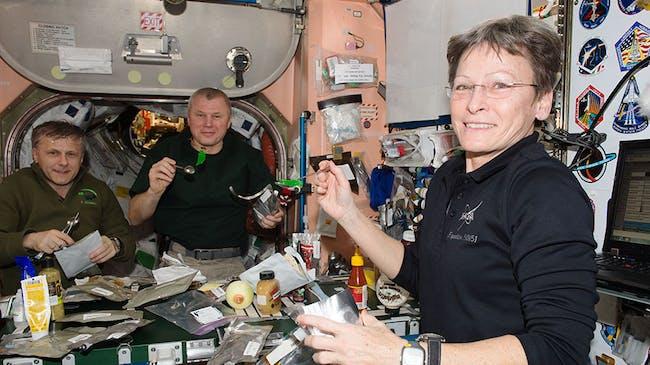 Expedition 50 crewmates (from left) Andrey Borisenko, Oleg Novitskiy and Peggy Whitson at mealtime in Unity module.