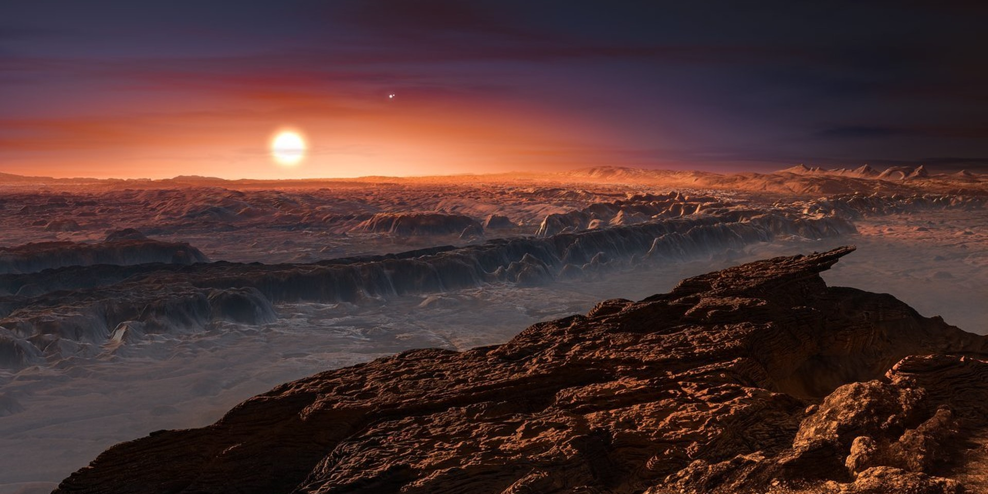 Artist's impression shows a view of the surface of the planet Proxima b orbiting the red dwarf star Proxima Centauri, the closest star to the Solar System.
