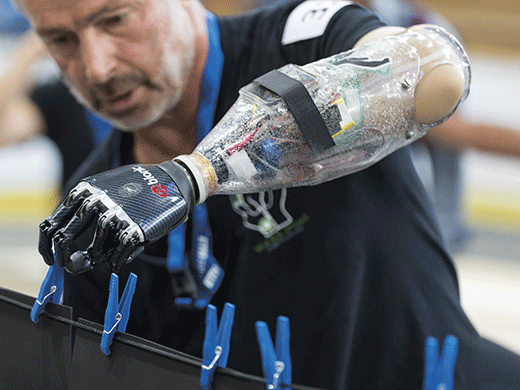 A competitor completing a challenge using a prosthetic arm.