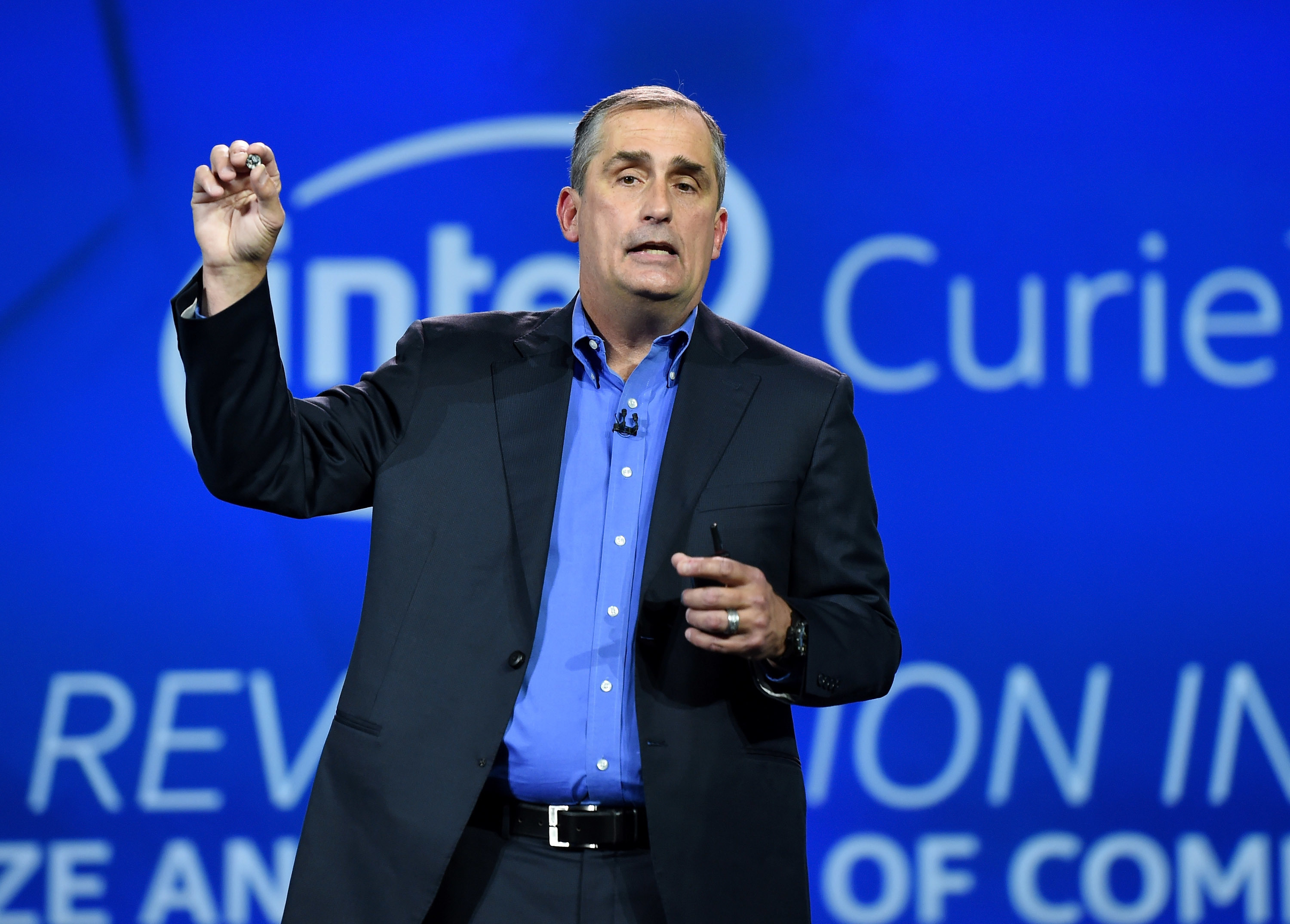 LAS VEGAS, NV - JANUARY 06:  Intel Corp. CEO Brian Krzanich unveils a wearable processor called Curie, a prototype open source computer the size of a button, at the 2015 International CES at The Venetian Las Vegas on January 6, 2015 in Las Vegas, Nevada.   (Photo by Ethan Miller/Getty Images)