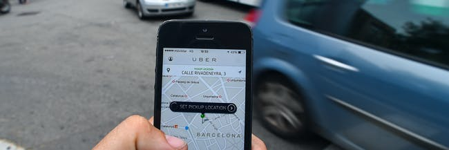 In this photo illustration the new smart phone taxi app 'Uber' shows how to select a pick up location on July 1, 2014 in Barcelona, Spain. Taxi drivers in various cities have been on strike over unlicensed car-hailing services. Drivers say that there is a lack of regulation behind the new app.