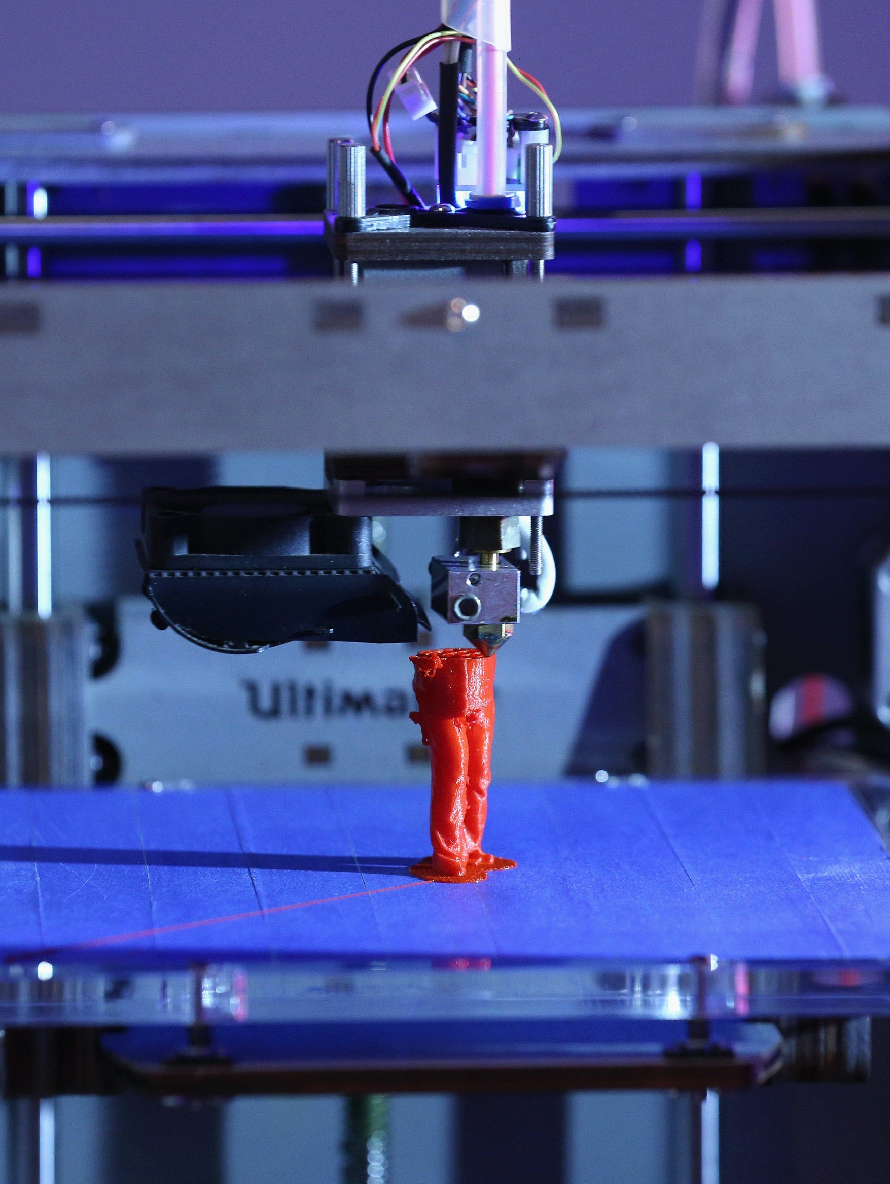 LONDON, ENGLAND - OCTOBER 08:  A 3D printer constructs a model human figure in the exhibition '3D: printing the future' in the Science Museum on October 8, 2013 in London, England. The exhibition, which opens to the public tomorrow, features over 600 3D printed objects ranging from: replacement organs, artworks, aircraft parts and a handgun.  (Photo by Oli Scarff/Getty Images)