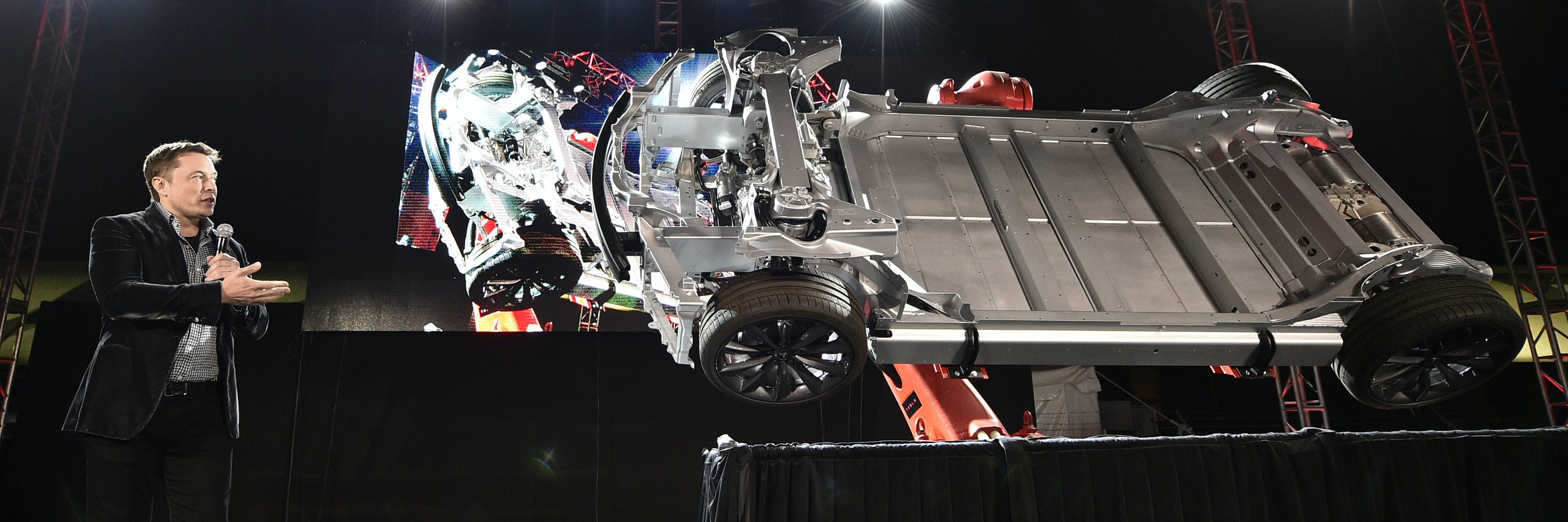 Elon Musk, CEO of Tesla, unveils the dual engine chassis of the new Tesla 'D' model at the Hawthorne Airport October 09, 2014 in Hawthorne, California. The 'D' is the faster  and all-wheel-drive version of the Model S electric sedan, capable of accelerating to 60 miles per hour in just over 3 seconds.