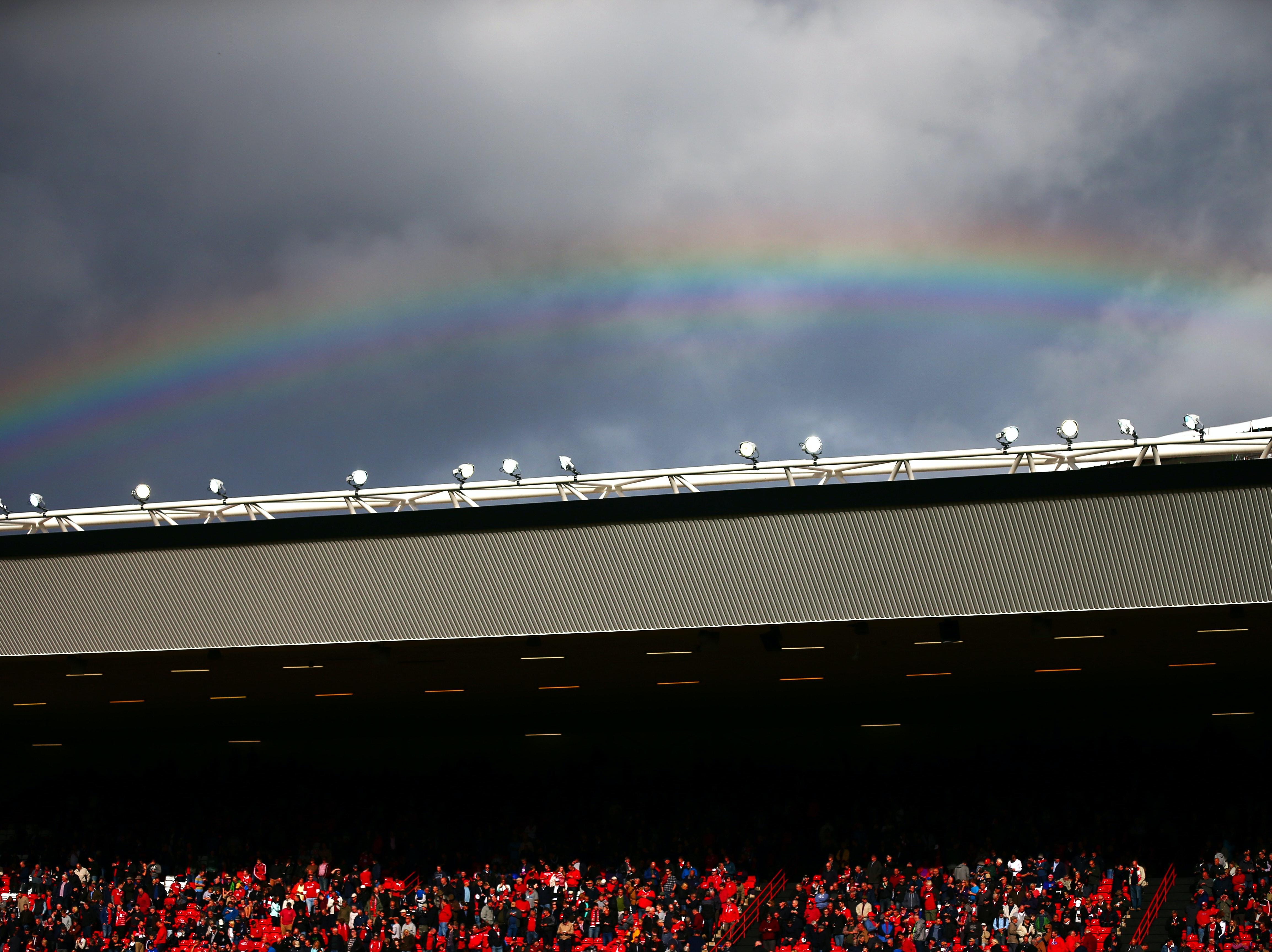 A rainbow forms over Bristol's Ashton Gate stadium.