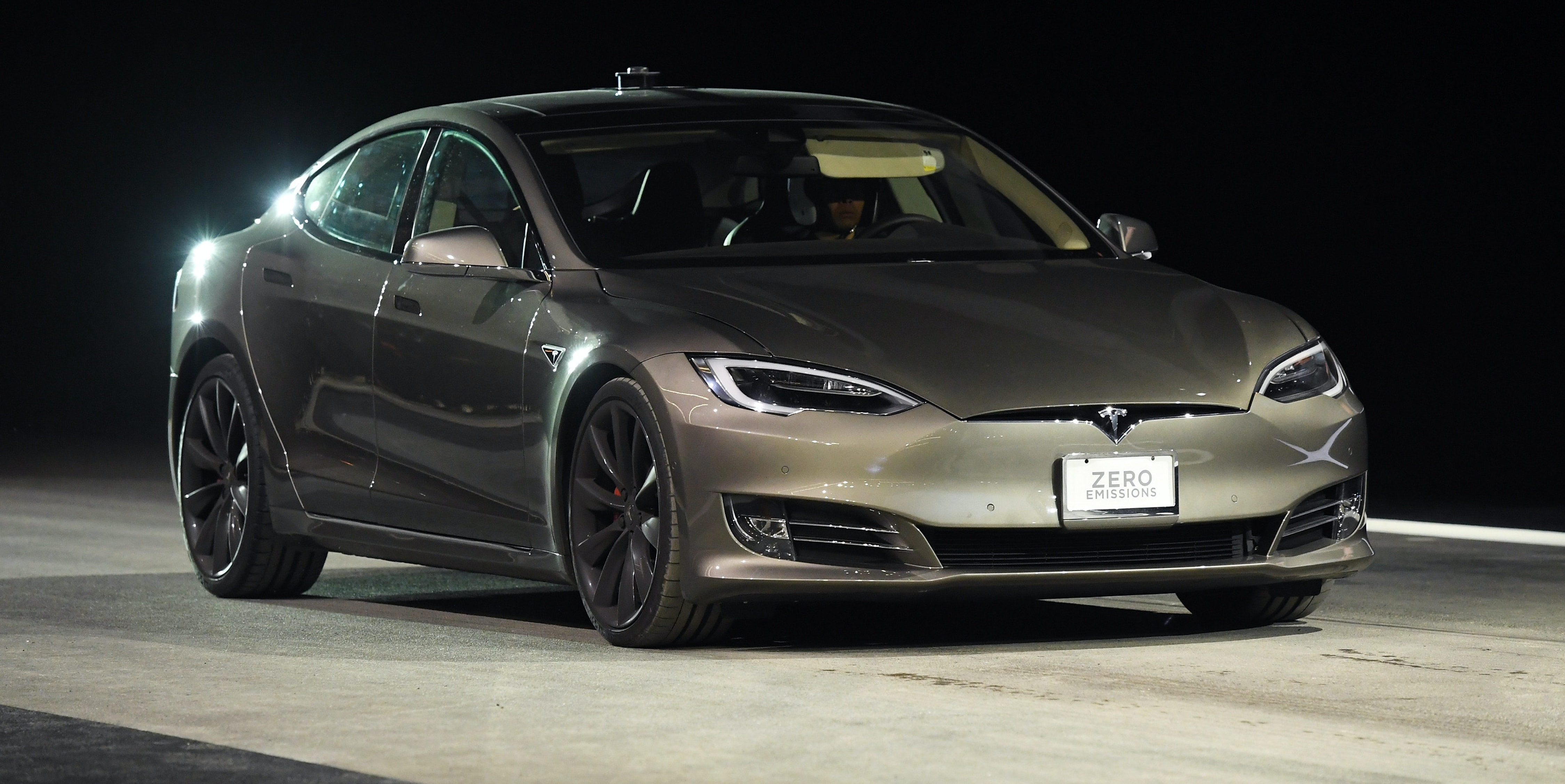 LAS VEGAS, NV - JANUARY 03:  A Tesla Model S P100D in Ludicrous Mode is shown during a speed test against Faraday Future's FF 91 prototype electric crossover vehicle (not shown) during the FF 91's unveiling at a press event for CES 2017 at The Pavilions at Las Vegas Market on January 3, 2017 in Las Vegas, Nevada. The 1,050-horsepower FF 91 features autonomous driving with 3D lidar and can go from 0 to 60 mph in 2.39 seconds. CES, the world's largest annual consumer technology trade show, runs from January 5-8 and is expected to feature 3,800 exhibitors showing off their latest products and services to more than 165,000 attendees.  (Photo by Ethan Miller/Getty Images)