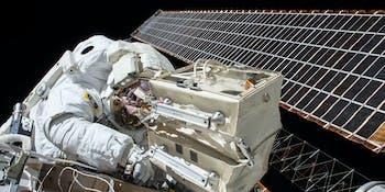 astronaut satellite solar panel