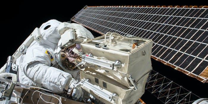 astronaut satellite solar panel