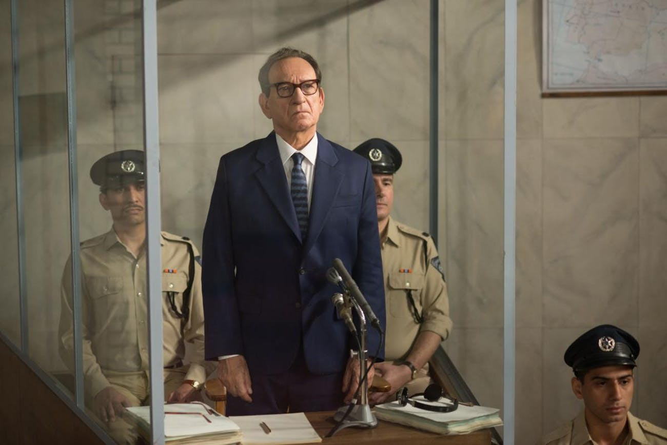 Sir Ben Kingsley's Adolf Eichmann stands trial in 'Operation Finale'.