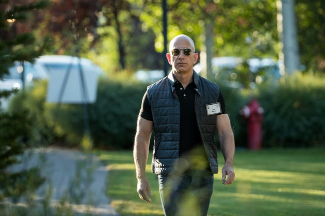 SUN VALLEY, ID - JULY 13: Jeff Bezos, chief executive officer of Amazon, arrives for the third day of the annual Allen & Company Sun Valley Conference, July 13, 2017 in Sun Valley, Idaho. Every July, some of the world's most wealthy and powerful businesspeople from the media, finance, technology and political spheres converge at the Sun Valley Resort for the exclusive weeklong conference. (Photo by Drew Angerer/Getty Images)