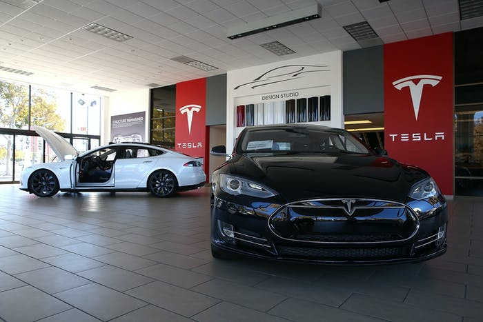 Cars like the Tesla Model S may find themselves whizzing around cities, picking up passengers.