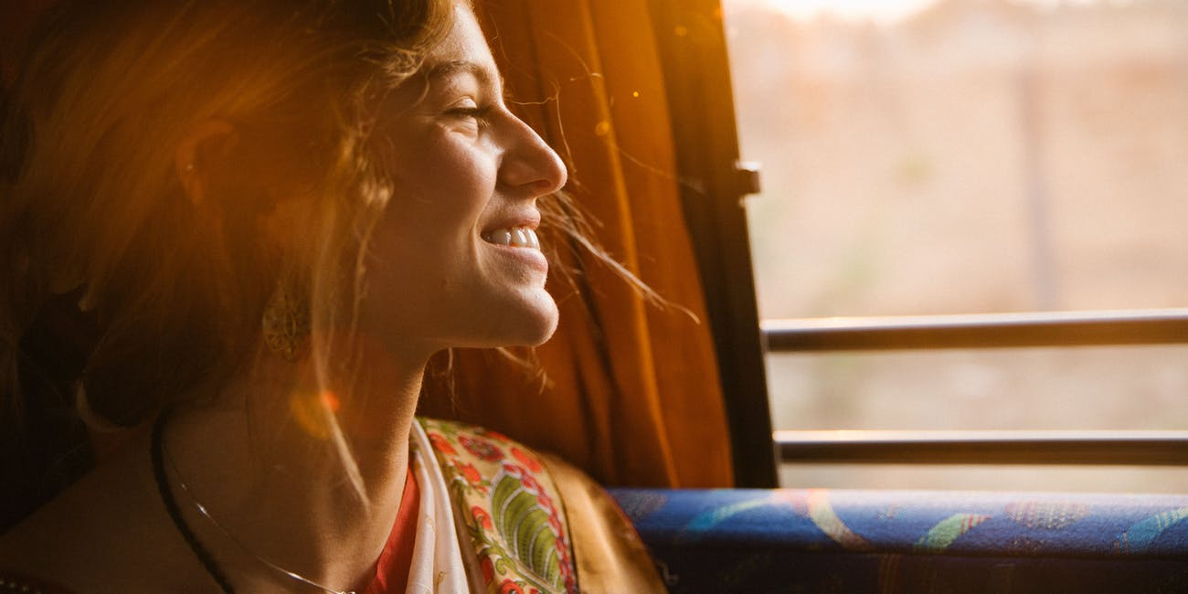 Woman on bus smiling