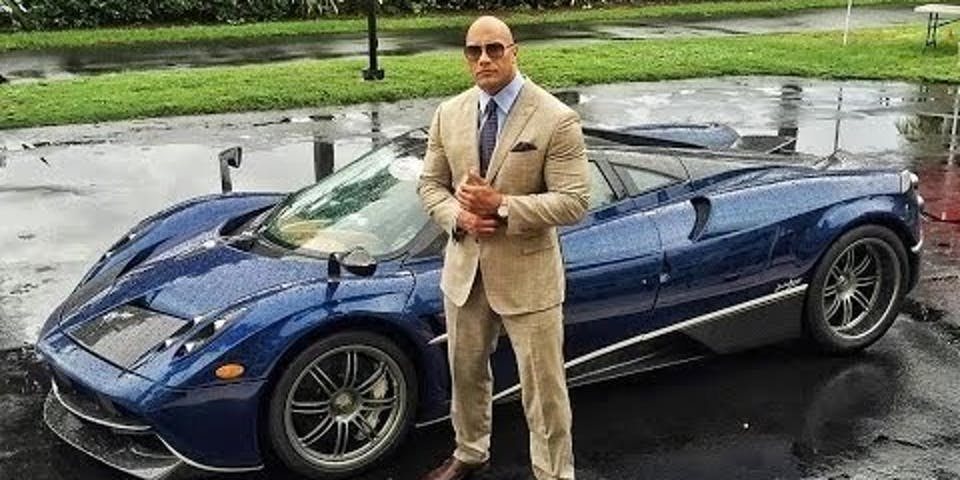 dwayne the rock johnson watch tan suit blue corvette sports car rain power dominance