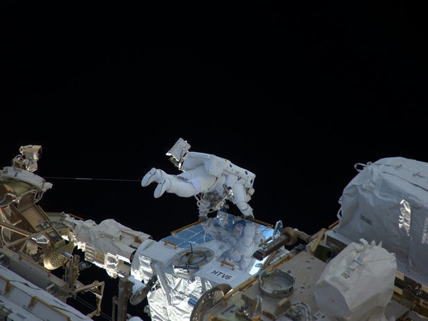 Here's a Picture of a French Astronaut Holding on for Dear Life