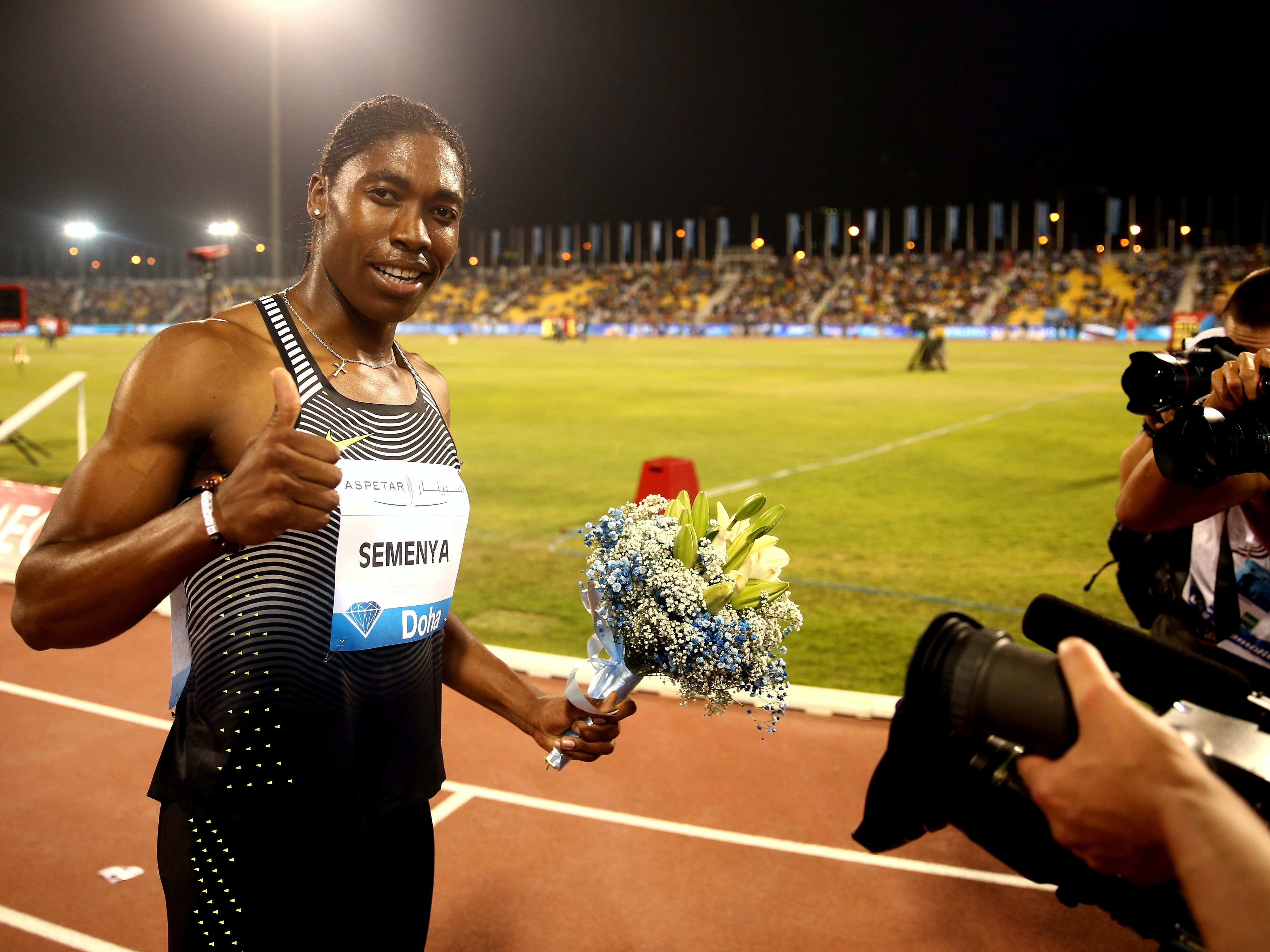 Caster Semenya of South Africa celebrates after victory in the Women's 800 meters final during the Doha IAAF Diamond League 2016 meeting at Qatar Sports Club.