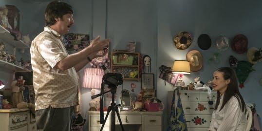 Miranda (Ballinger) with her Uncle Jim (Steve Little).