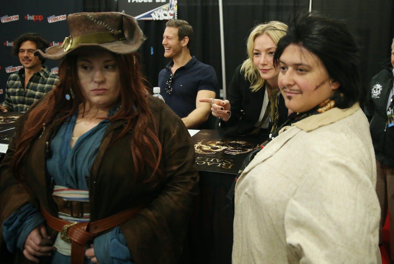 Luke Arnold, Tom Hopper, and Clara Paget sign autographs for fans