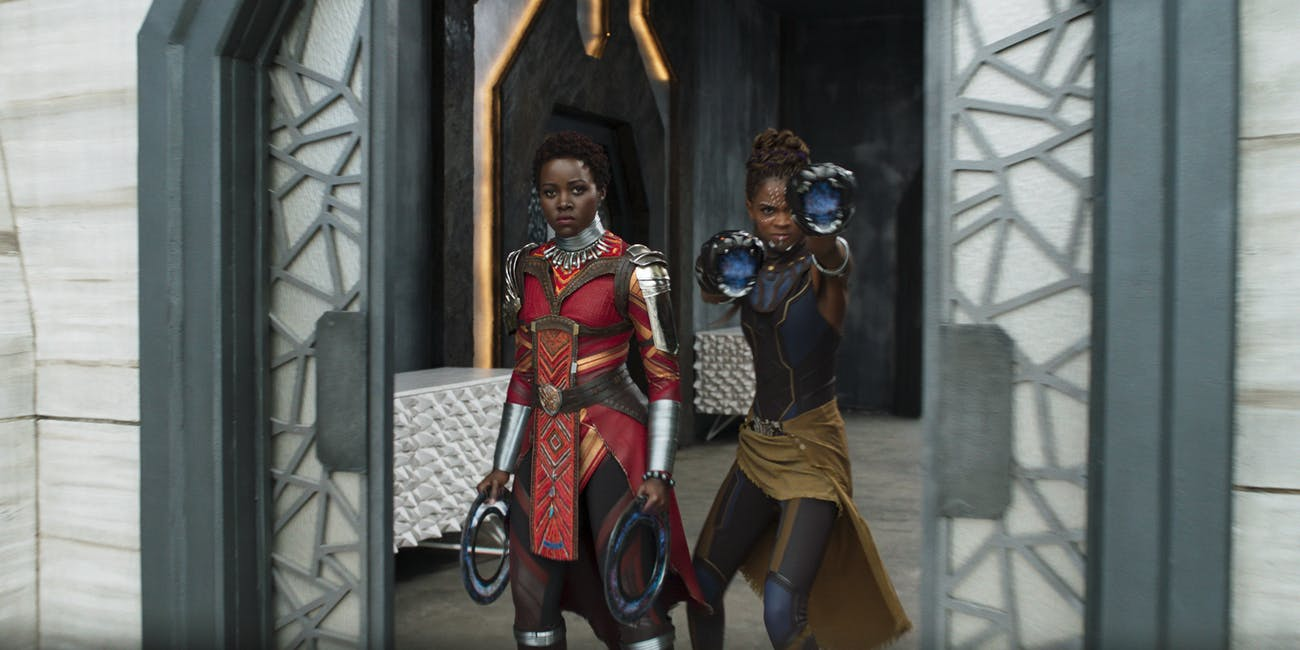 L to R: Nakia (Lupita Nyong'o) and Shuri (Letitia Wright) in 'Black Panther'