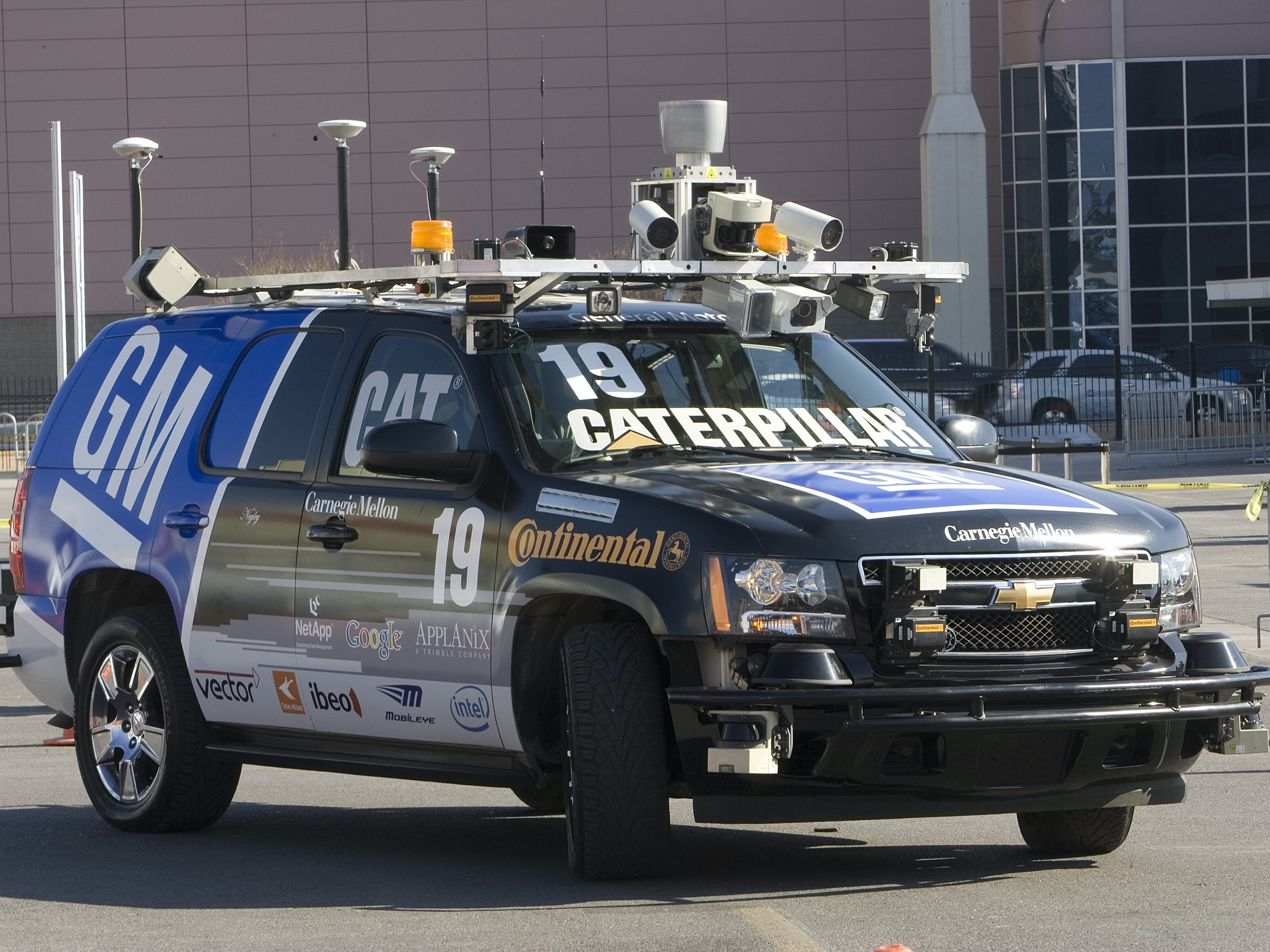 LAS VEGAS, NV - JANUARY 9:  'The Boss'  a driver-less automobile is seen at the 2008 International Consumer Electronics Show at the Las Vegas Convention Center January 9, 2008 in Las Vegas, Nevada. Using a combination of LIDAR, radar, vision and mapping GPS systems to see the world around it, the unmanned Chevrolet Tahoe used only electronics to successfully drive itself through a 60-mile urban course in November 2007 to win the prestigious U.S. Defense Department sponsored competition, DARPA Urban Challenge. The prototype vehicle recognizes road geometry and perceives other traffic and obstacles on the road.  CES, the world's largest annual consumer technology tradeshow, runs through tomorrow and features 2,700 exhibitors showing off their latest products and services to more than 140,000 attendees.  (Photo by David Paul Morris/Getty Images)