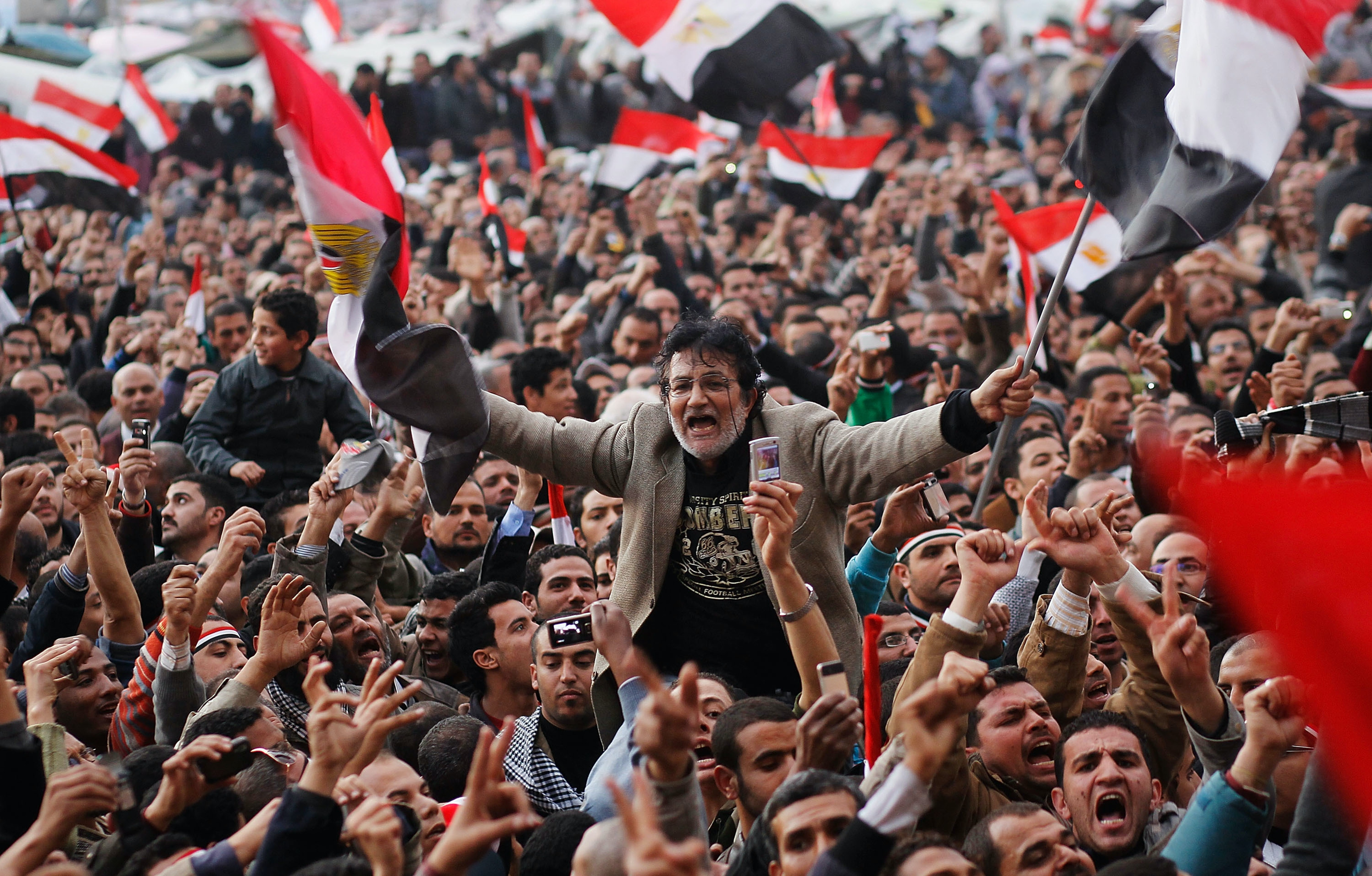 An anti-government protester is carried on shoulders in the afternoon before a speech by Egyptian President Hosni Mubarak in Tahrir Square February 10, 2011 in Cairo, Egypt.