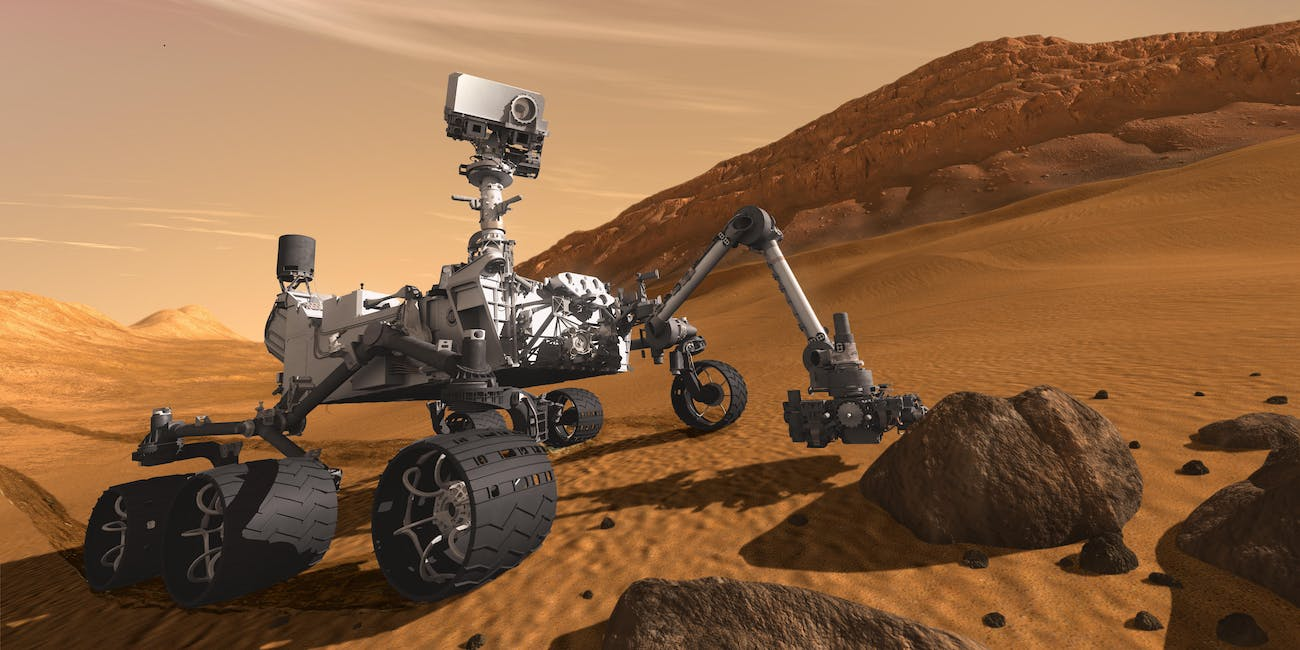 This artist concept features NASA Mars Science Laboratory Curiosity rover, a mobile robot for investigating Mars past or present ability to sustain microbial life. The rover examines a rock on Mars with a set of tools at the end of the rover arm.