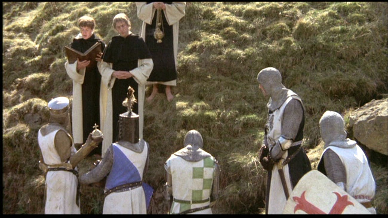 King Arthur holding the Holy Hand Grenade listening to the instructions.