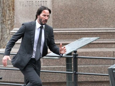 Keanu Reeves Runs With Hero Dog in These New 'John Wick 2' Set Photos