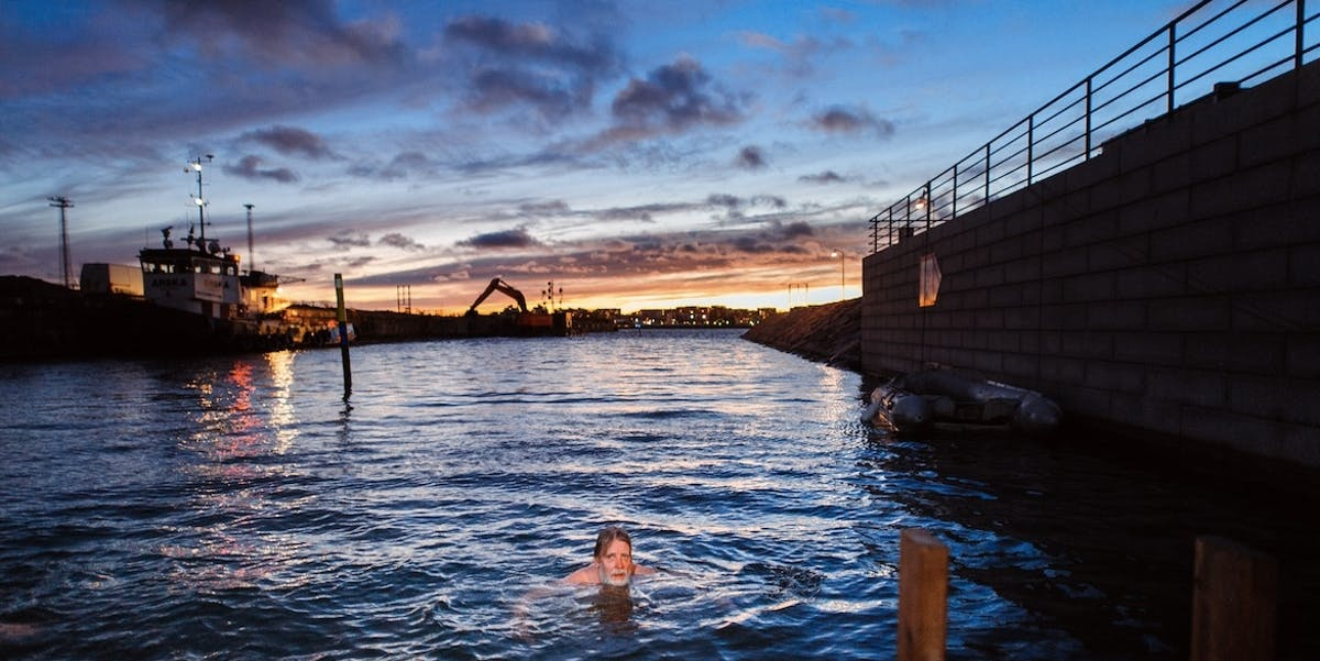 A local swims in Kalasatama during Helsinki Sauna Day.