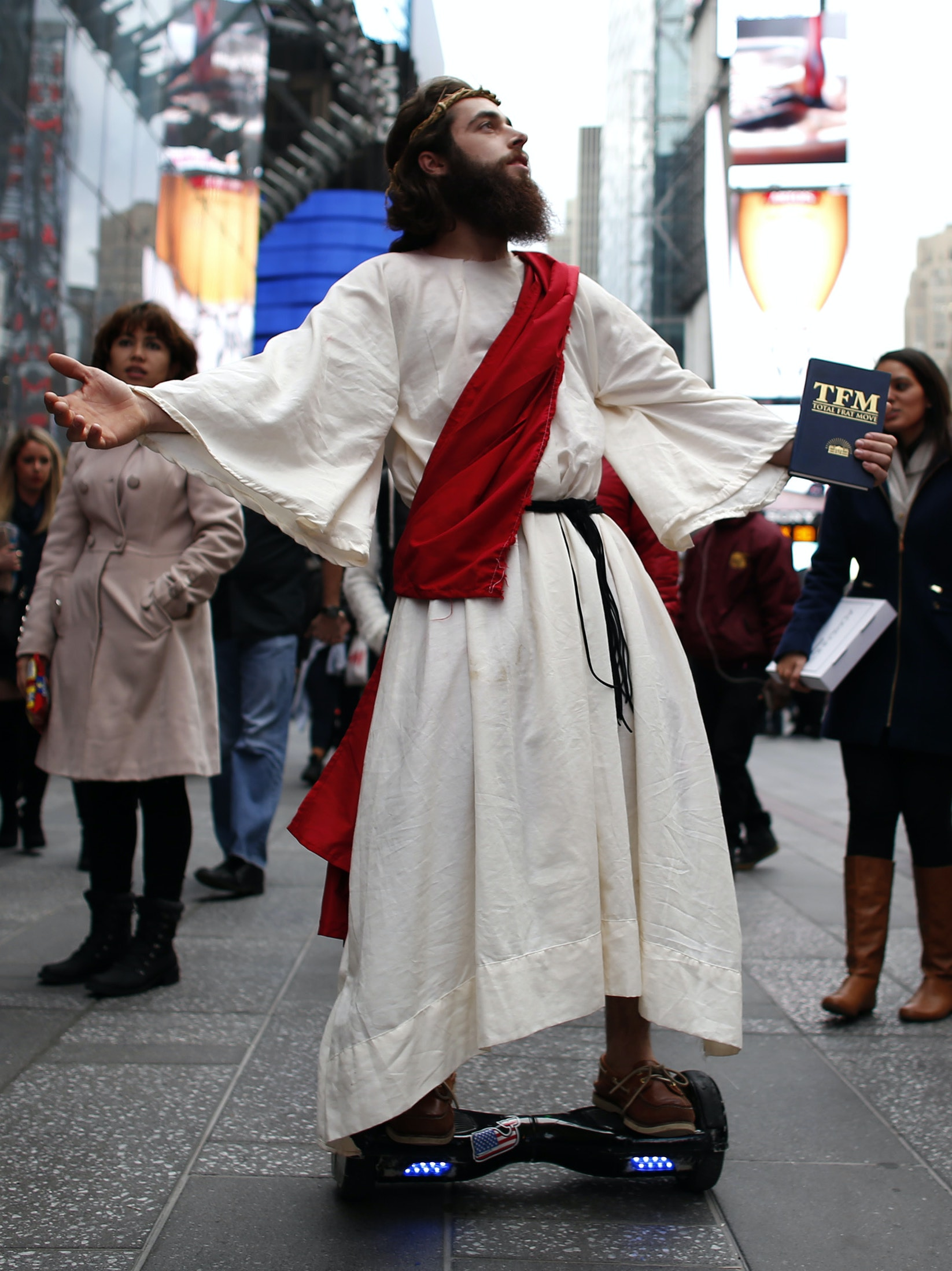 NEW YORK, NY - OCTOBER 31: A man dressed as Jesus Christ passes by on Times Square before the 42nd Annual Halloween Parade October 21, 2015 in New York City. (Photo by Kena Betancur/Getty Images)