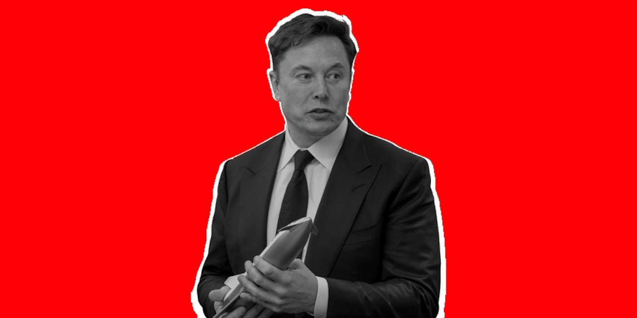 Elon Musk holding model of Starship rocket.