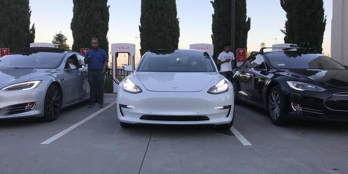 Here's the Model 3 in the middle next to two Model S's.