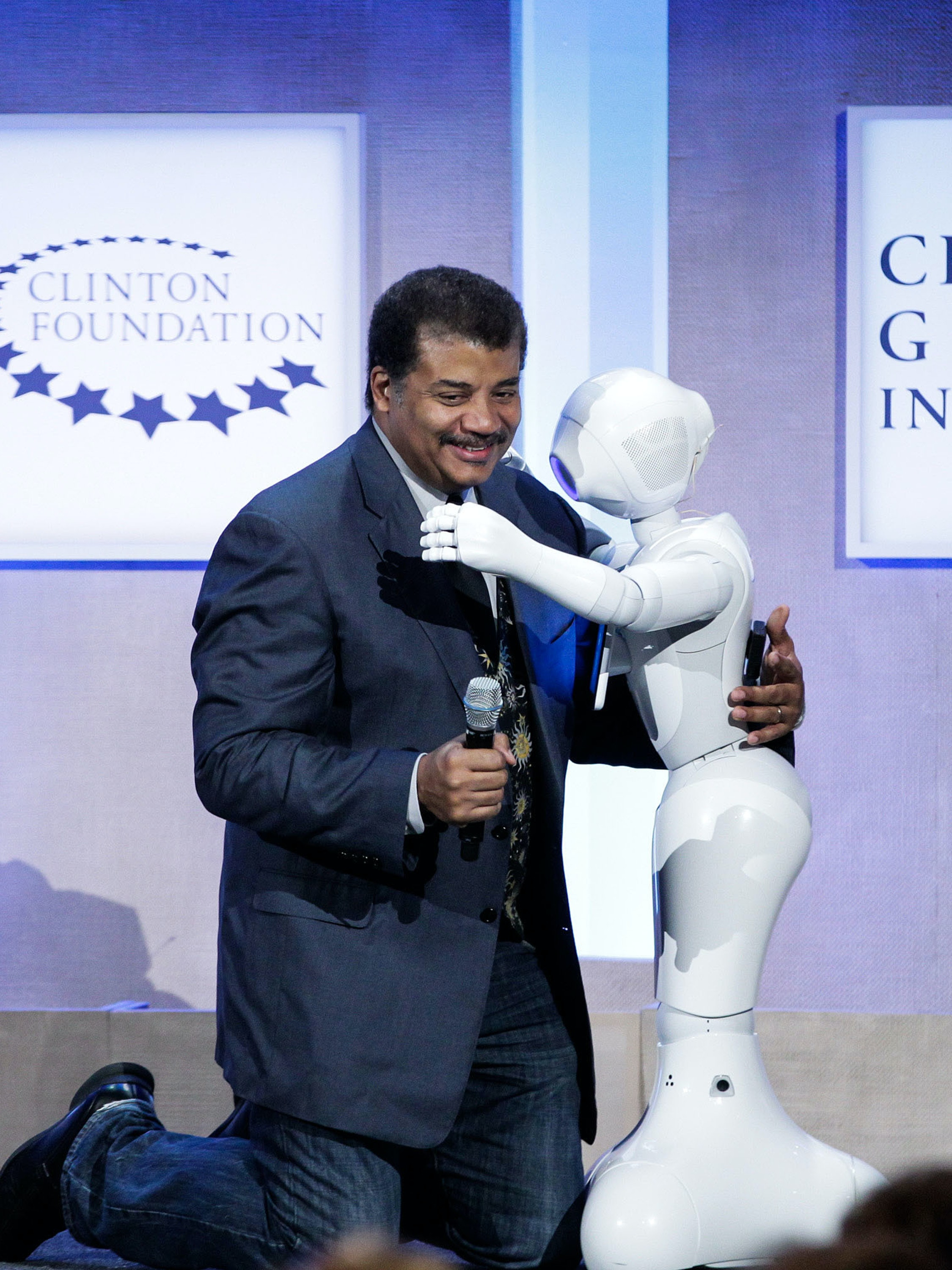 Neil deGrasse Tyson, Astrophysicist, American Museum of Natural History hugs Pepper, Social Humanoid Robot at the Looking to the Next Frontier session during the third day of the 2015 Clinton Global Initiative's Annual Meeting at the Sheraton New York Hotel & Towers on September 28, 2015 in New York City.