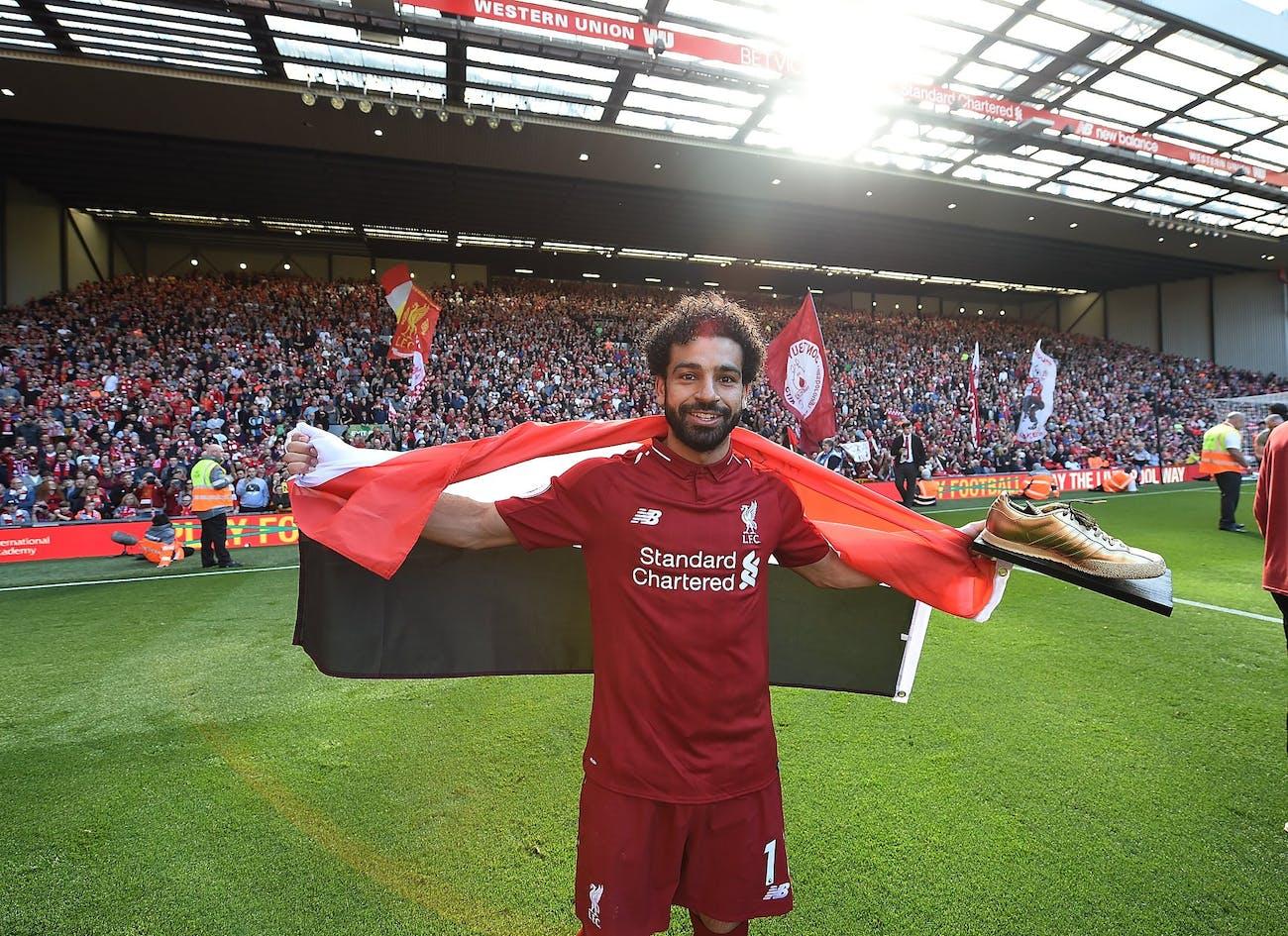 Mo Salah plays for Liverpool FC during the club season.