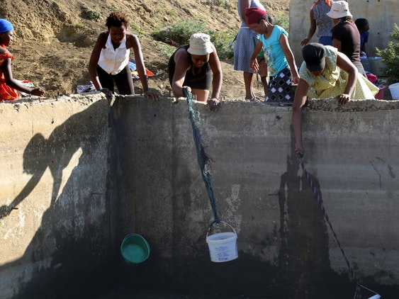 South African women trying to soak up stagnant water during the drought in January 2016.