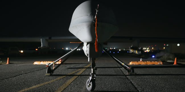 UNSPECIFIED, PERSIAN GULF REGION - JANUARY 07:  A U.S. Air Force MQ-1B Predator unmanned aerial vehicle (UAV), awaits a mission at an air base in the Persian Gulf region on January 7, 2016. The U.S. military and coalition forces use the base, located in an undisclosed location, to launch drone airstrikes against ISIL in Iraq and Syria, as well as to transport cargo and and troops supporting Operation Inherent Resolve. The Predators at the base are operated and maintained by the 46th Expeditionary Reconnaissance Squadron, currently attached to the 386th Air Expeditionary Wing.  (Photo by John Moore/Getty Images)