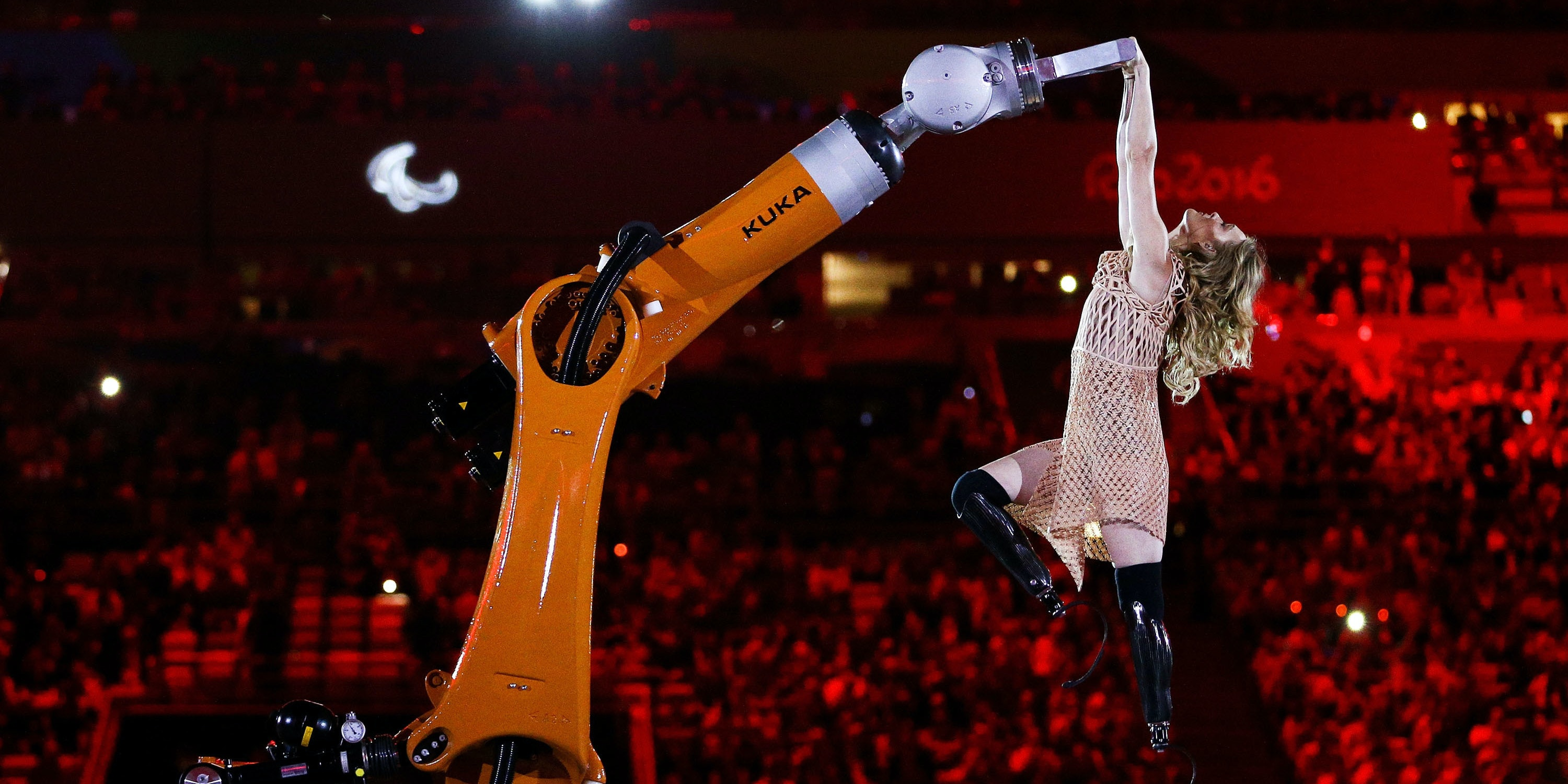 RIO DE JANEIRO, BRAZIL - SEPTEMBER 07:  Amy dances with robot Kuka during the Opening Ceremony of the Rio 2016 Paralympic Games at Maracana Stadium on September 7, 2016 in Rio de Janeiro, Brazil.  (Photo by Hagen Hopkins/Getty Images)