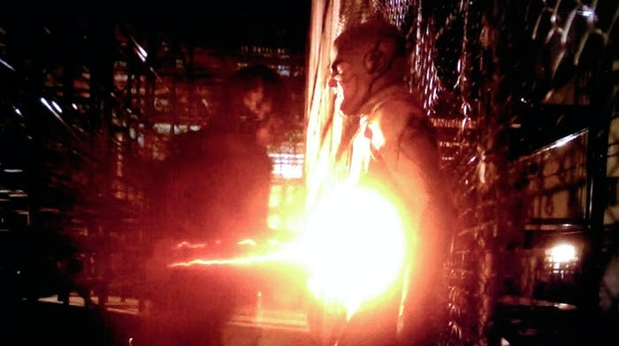 """The Flash subdues the Reverse Flash with super-speed stomach punches, on the CW show """"The Flash."""""""