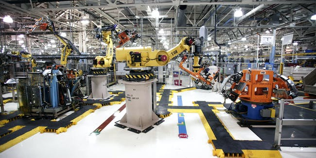 Robots at the Fiat Chrysler Automobiles US Warren Stamping Plant  are shown January 22, 2016 in Warren, Michigan. FCA US officially dedicated the new press line featuring a $63 million high-speed press at the plant today.