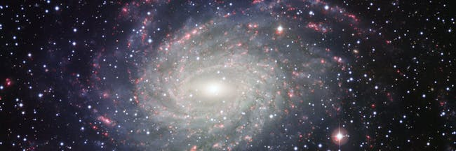 This picture of the nearby galaxy NGC 6744 was taken with the Wide Field Imager on the MPG/ESO 2.2-metre telescope at La Silla. The large spiral galaxy is similar to the Milky Way, making this image look like a picture postcard of our own galaxy sent from extragalactic space.