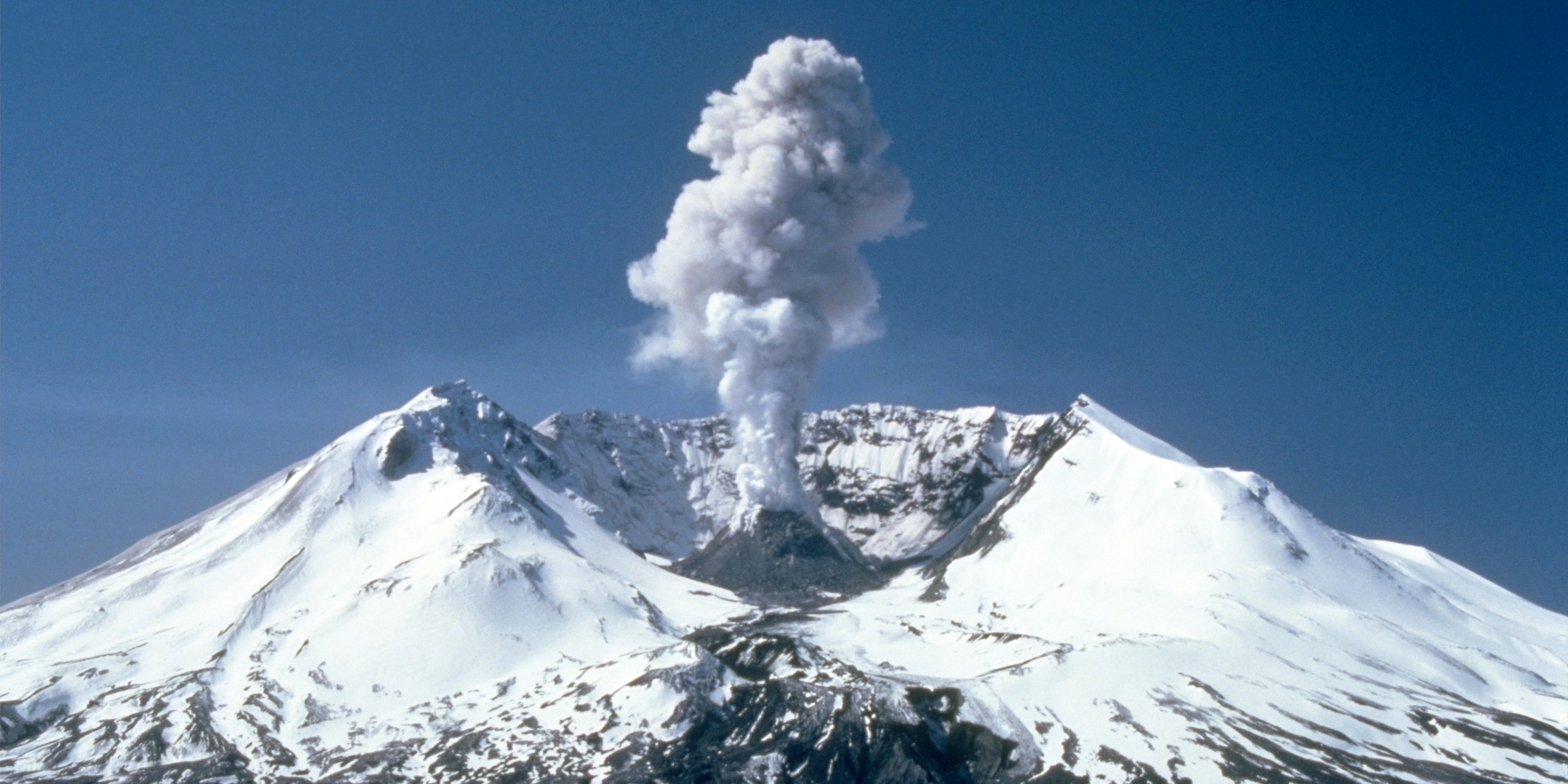 Plumes of steam, gas, and ash often occurred at Mount St. Helens in the early 1980s. On clear days they could be seen from Portland, Oregon, 50 mi (80 km) to the south. The plume photographed here rose nearly 3,000 ft (910 m) above the volcano's rim. The view is from Harrys Ridge, 5 mi (8 km) north of the mountain.