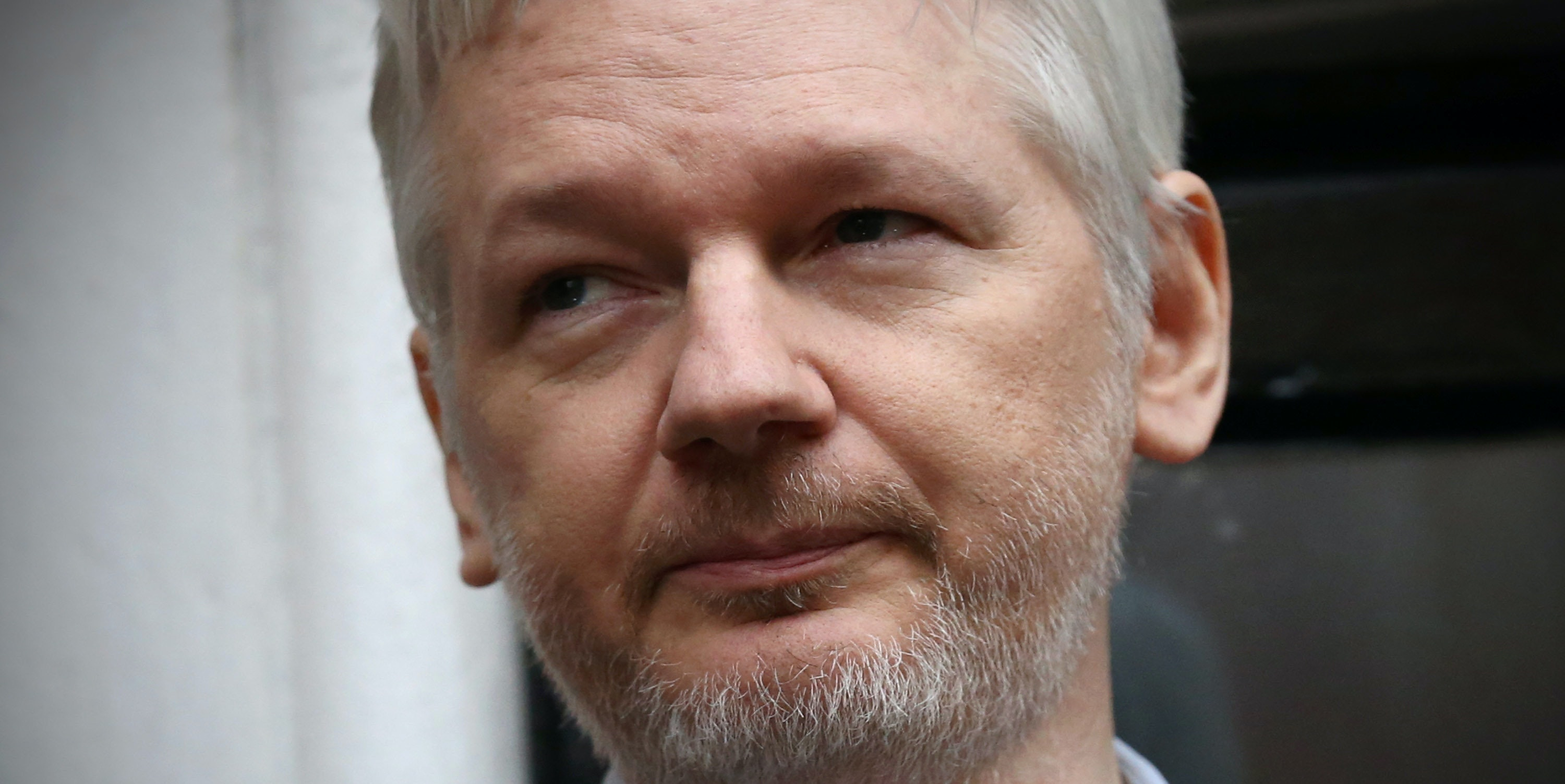LONDON, ENGLAND - FEBRUARY 05:  Wikileaks founder Julian Assange speaks from the balcony of the Ecuadorian embassy where  he continues to seek asylum following an extradition request from Sweden in 2012, on February 5, 2016 in London, England. The United Nations Working Group on Arbitrary Detention has insisted that Mr Assange's detention should be brought to an end.  (Photo by Carl Court/Getty Images)