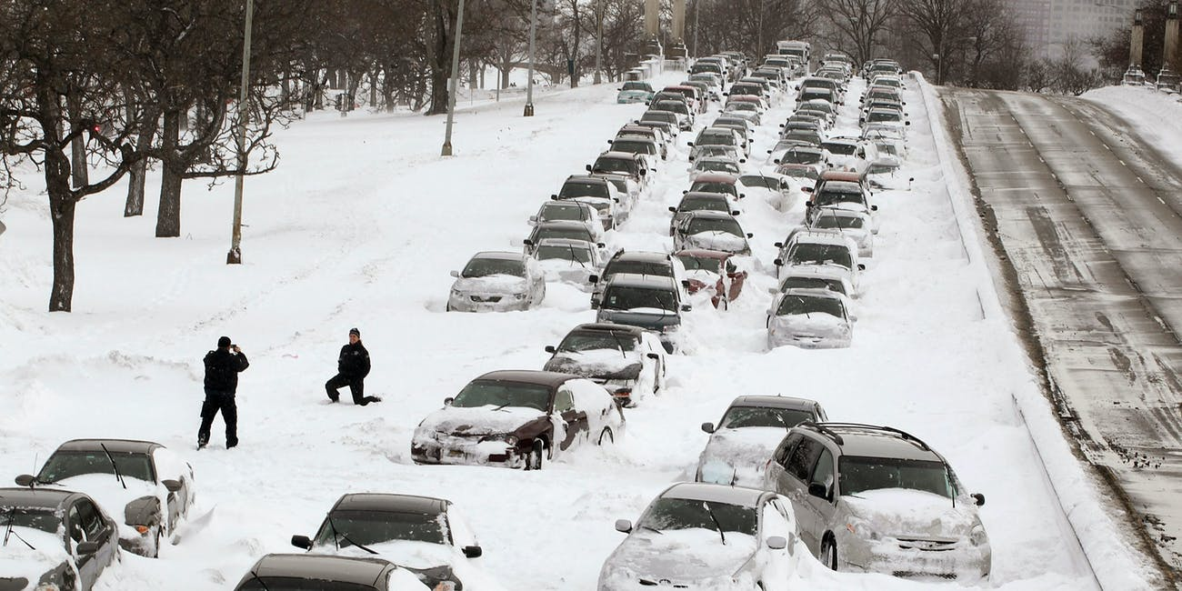Cars stuck in snow blizzard