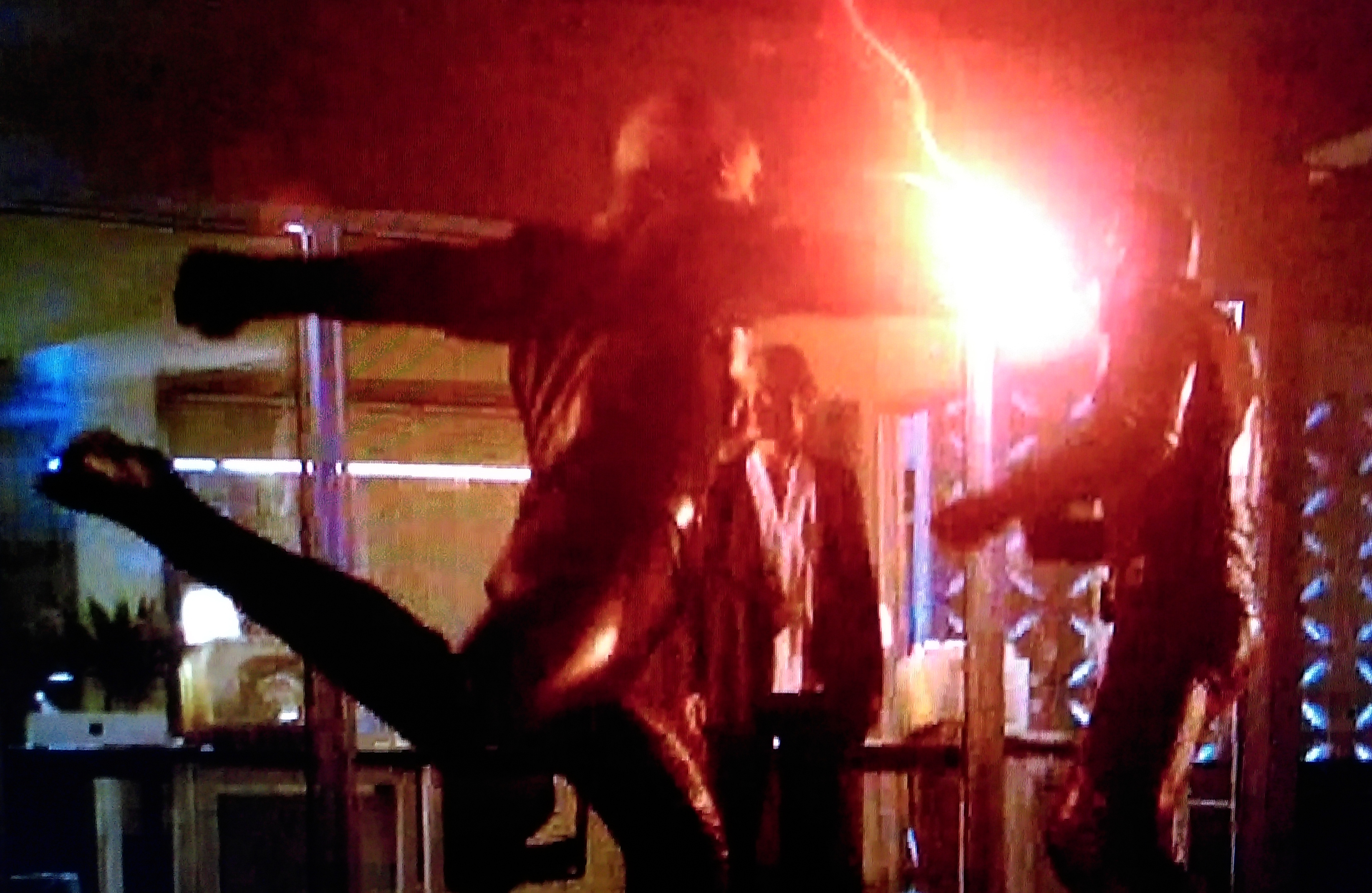 "Reverse-Flash punches Flash, on the CW show ""The Flash."""