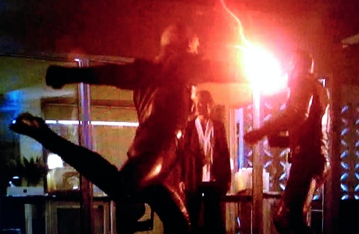 """Reverse-Flash punches Flash, on the CW show """"The Flash."""""""