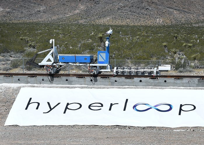 A recovery vehicle moves a test sled down a track after the first test of the propulsion system at the Hyperloop One Test and Safety site on May 11, 2016 in North Las Vegas, Nevada.