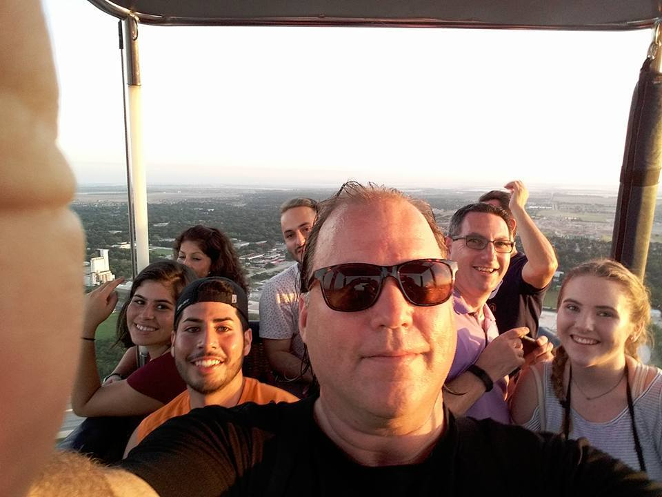 In this photo posted on his Facebook page on July 21, Nichols takes a selfie passengers in his hot air balloon.