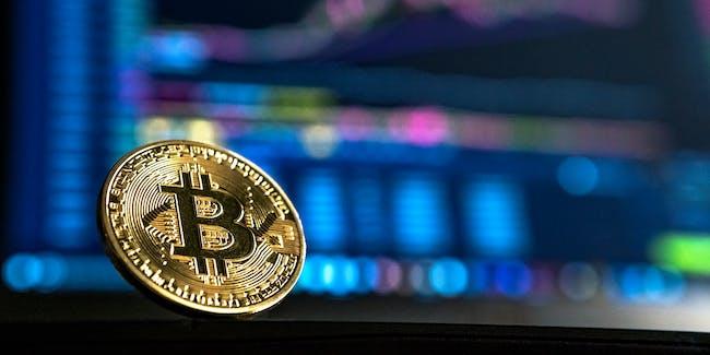 Bitcoin behind a computer