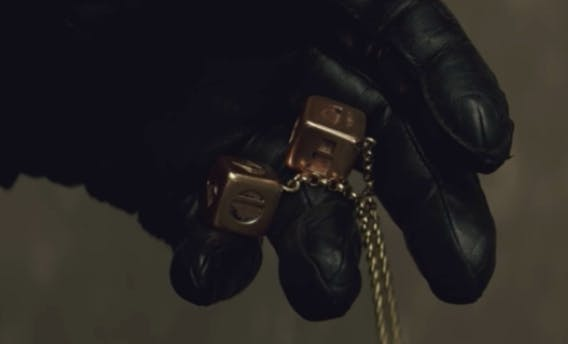 Kylo Ren holding the dice in 'The Last Jedi'