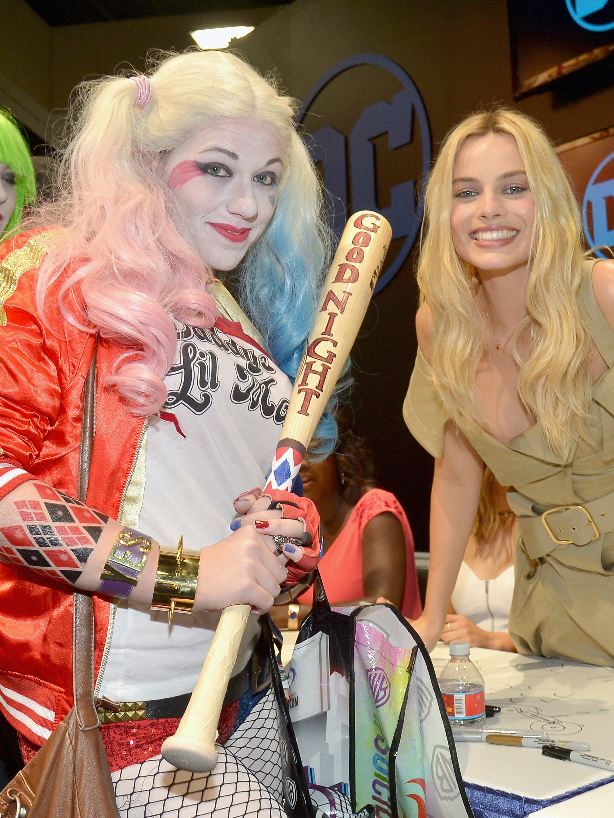 SAN DIEGO, CA - JULY 23:  Actress Margot Robbie (R) from the cast of Suicide Squad film poses with a cosplayer in DC's 2016 Comic-Con booth at San Diego Convention Center on July 23, 2016 in San Diego, California.  (Photo by Charley Gallay/Getty Images for DC Entertainment)
